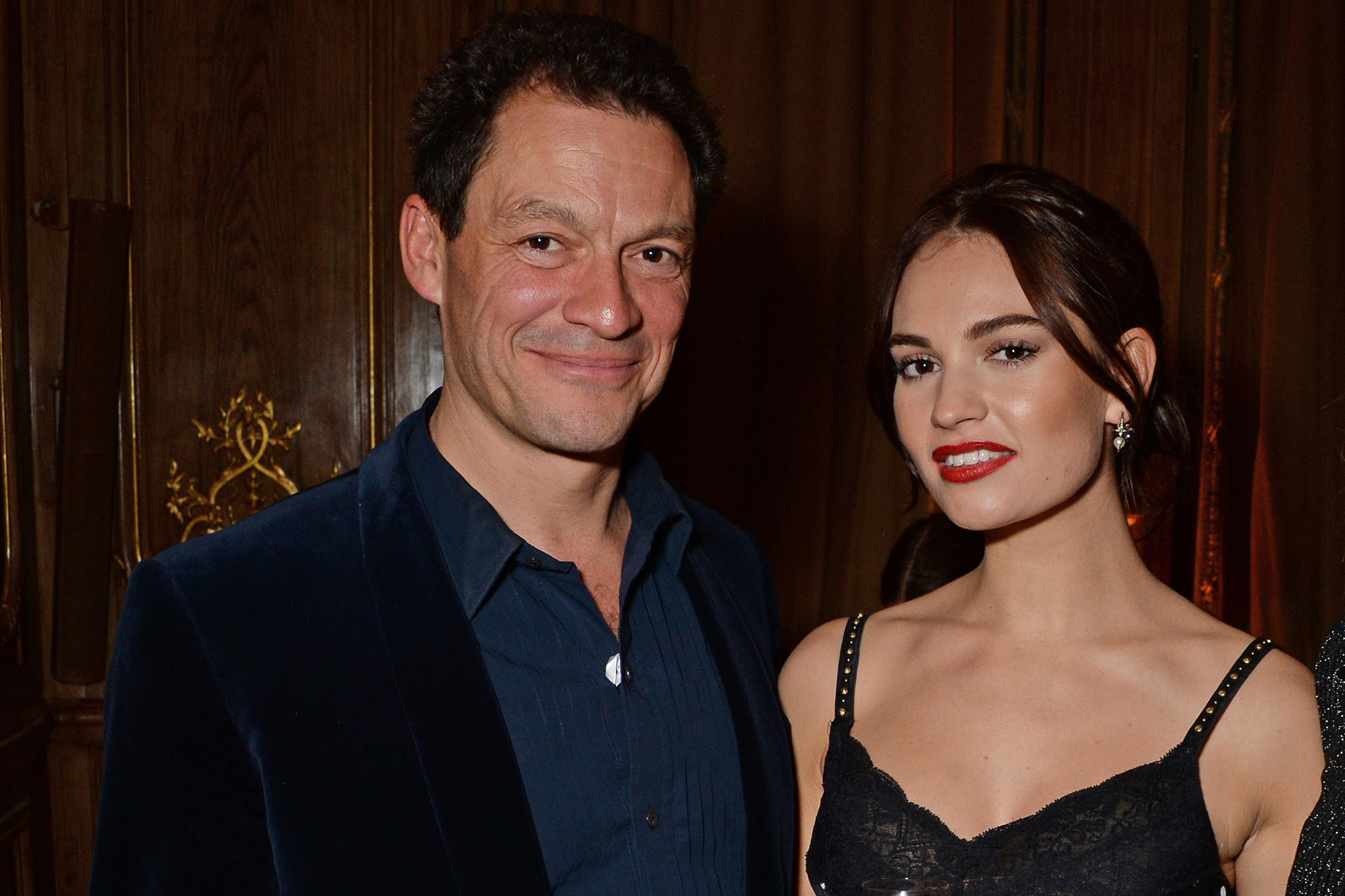 Lily James cozies up to married co-star Dominic West in Rome