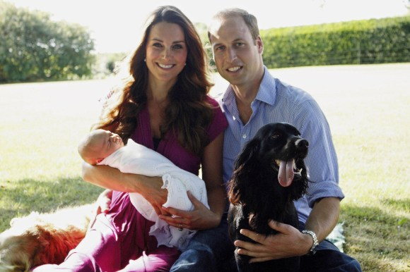 Kate Middleton, Prince William and their son, Prince George, with dog Lupo in August 2013