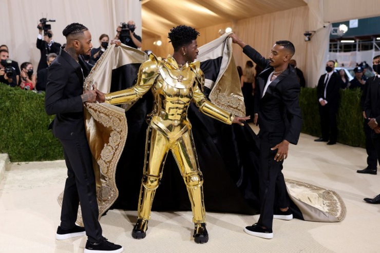 Lil Nas X stands out in three golden outfits on the Met Gala red carpet