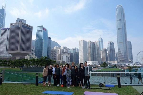 Tamar Park yoga with the Hong Kong skyline