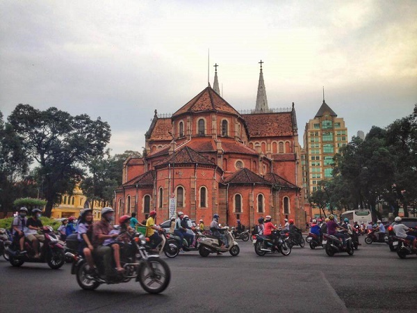 Notre Dame Cathedral and scooter traffic in Saigon, Vietnam