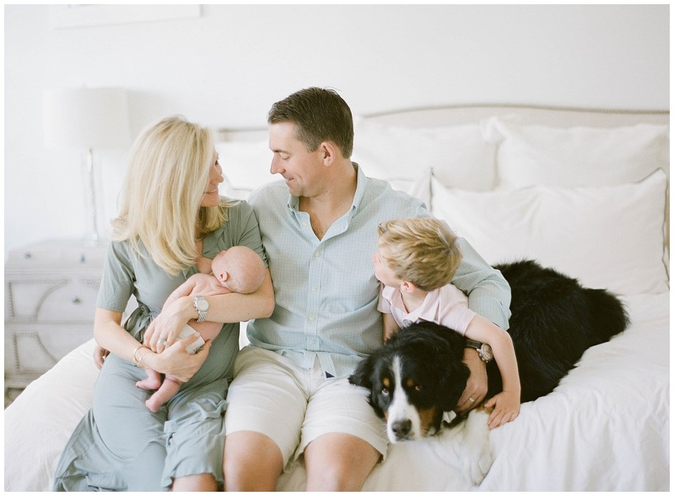 Denver family photographer - in home newborn session family on bed portraits