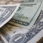 Dólar encerra a semana em queda de 0,06%