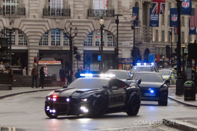 Filming of 'Transformers: The Last Knight' in London. Confused bystanders watch as a dramatic police car chase is filmed around Picadilly early this morning.  In these scene Bumblebee (the yellow car) is being chased by Barricade (the police car). Featuring: Atmosphere Where: London, United Kingdom When: 25 Sep 2016 Credit: WENN.com