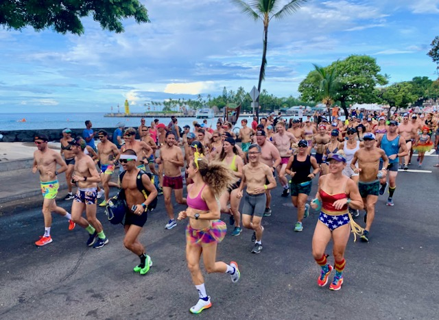 Triathletes running down Ali'i Drive during the 2019 Kona Underpants Run