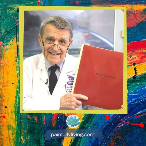 Smiling older man wearing glasses at the tip of his nose, wearing a white doctor's coat (Dr. John Sarno).