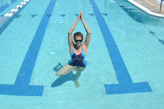 woman doing yoga in the pool
