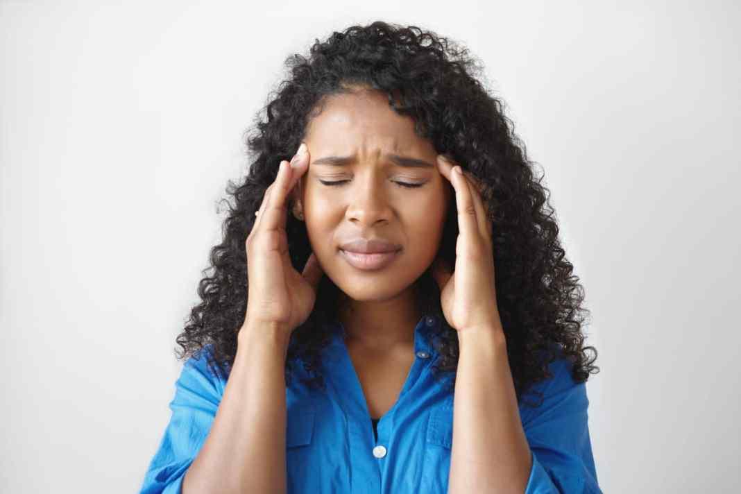 Black woman fighting chronic pain