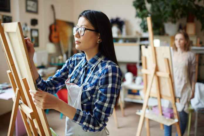 Pain-Friendly Hobbies young woman painting