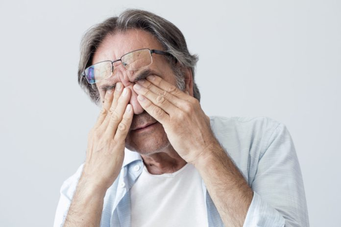 man suffering with stress and joint pain