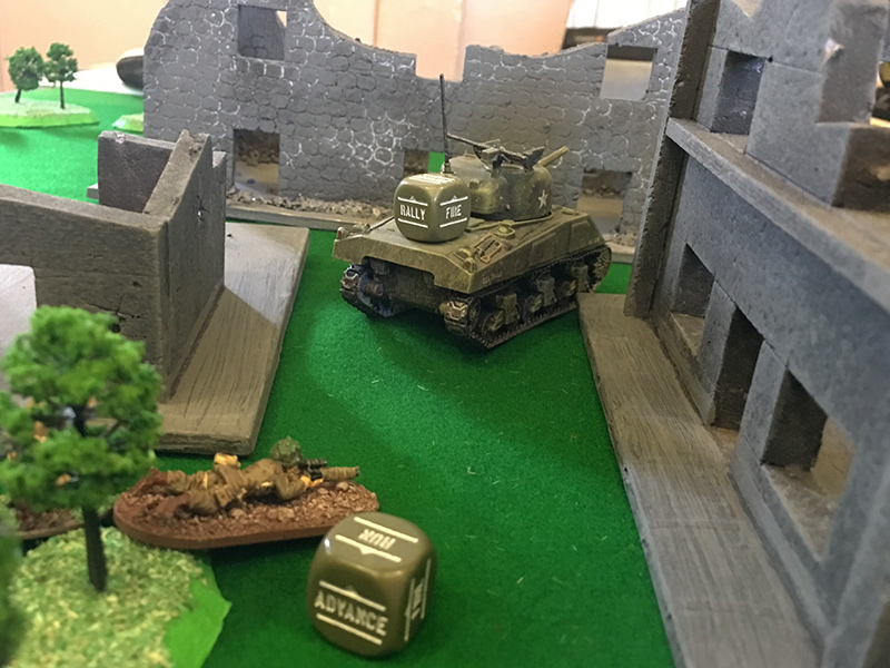 The Sherman sneaks forward to get sight of the Tiger while the sniper team advanced towards the house