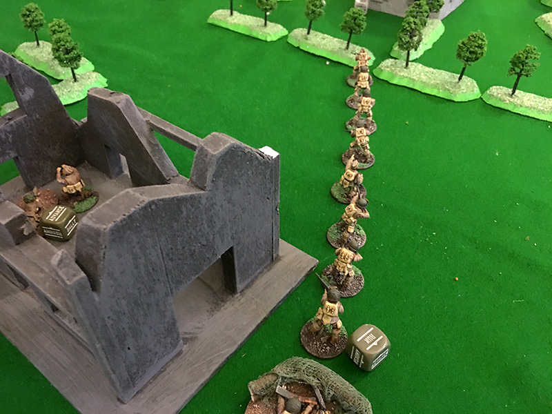 Airborne Squad 2 run across the open land after the GIs were wiped out by the Germans in the house