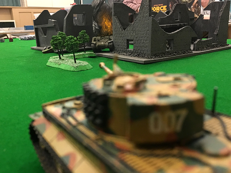 The Tiger looks on as the Sherman burns. The crew escaped but the Americans didn't have any models to depict them.