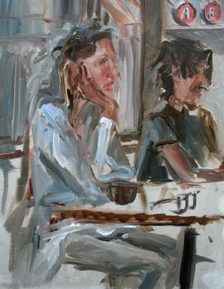 Two customers at separate tables at Quack's
