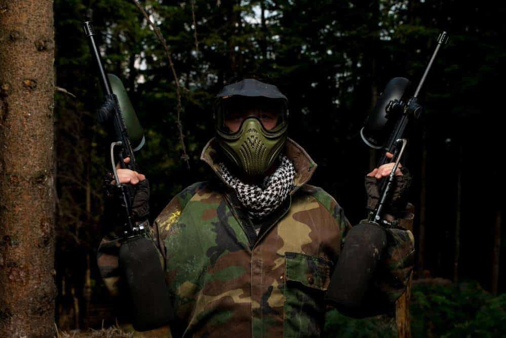 Paintball player with two guns