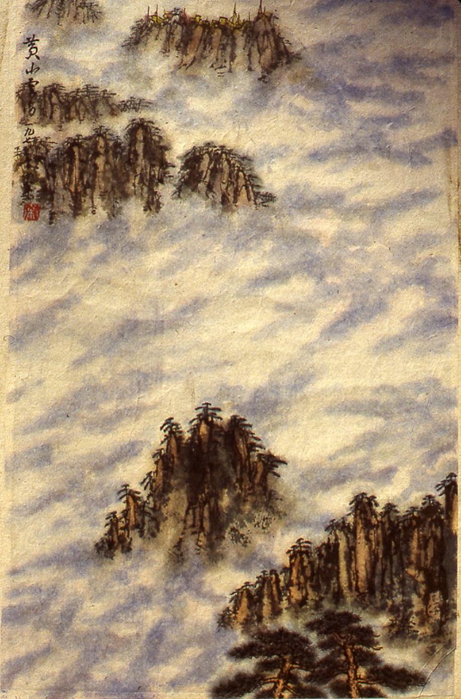 Image of Mountain treetops through fog