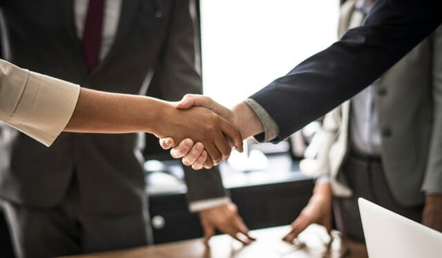 business boardroom handshake