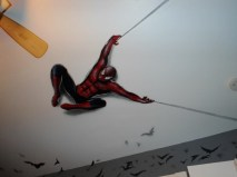 Here is a mural of Spiderman that I painted on a Child's bedroom wall. It was created using regular Airbrush paint by USARTSUPLLY.COM on top of house paint from the paint store.