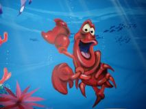 Here is a mural of Sebastian from The Little Mermaid, that I painted on a Child's bedroom wall. It was created using regular Airbrush paint by USARTSUPLLY.COM on top of house paint from the paint store.