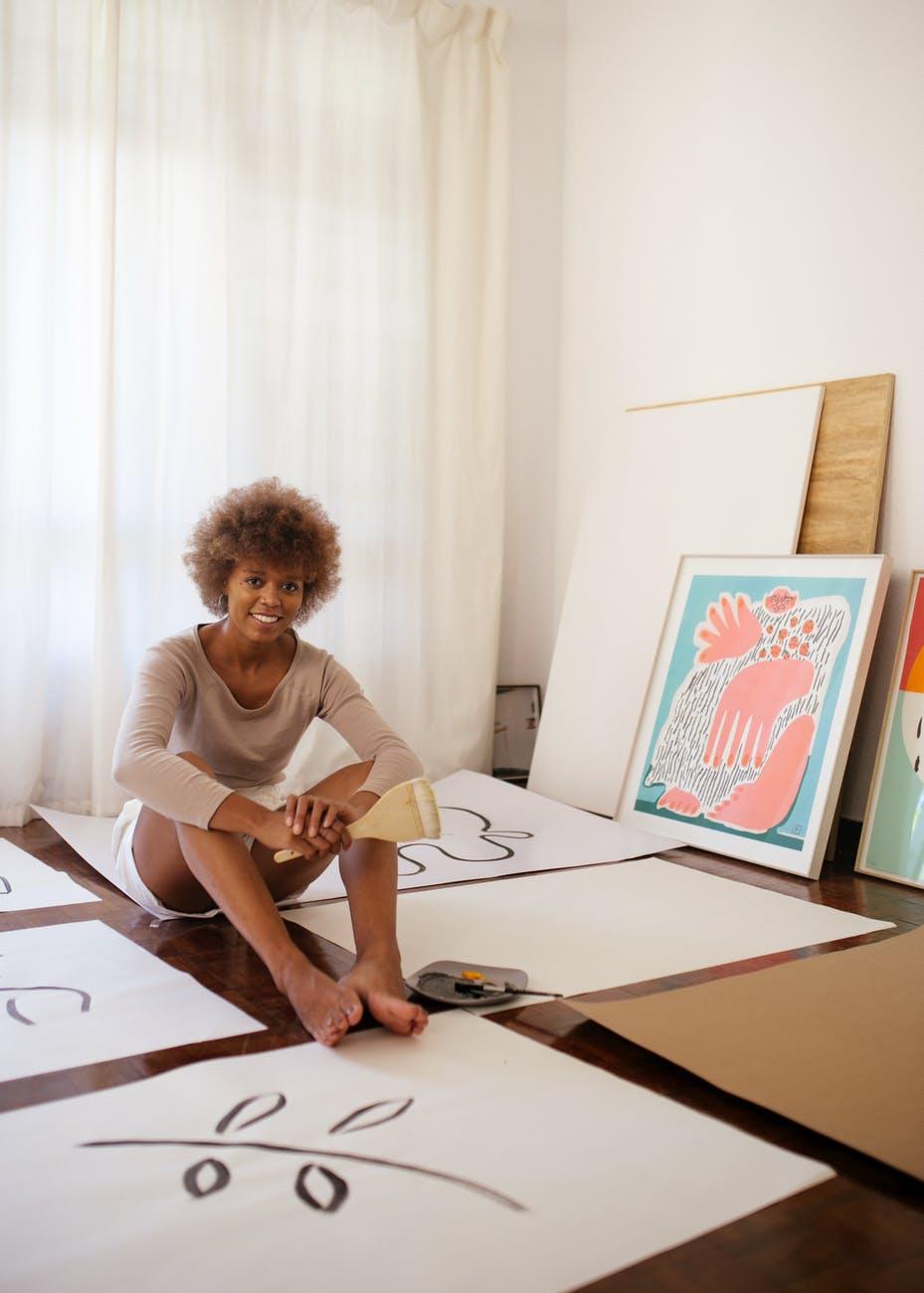 positive female artist smiling at camera