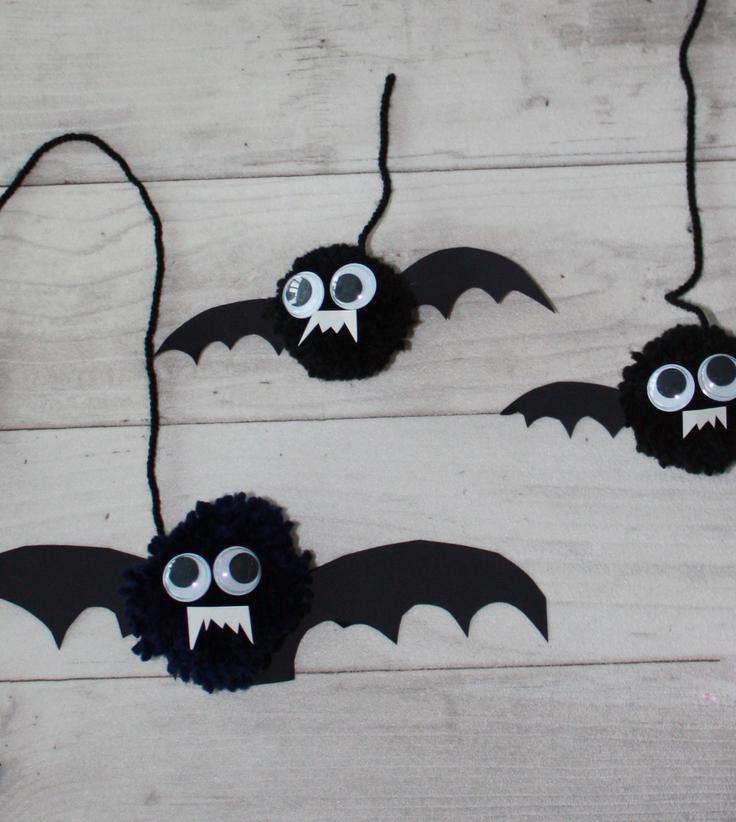 Pom Pom Bat Halloween Decorations on wooden background