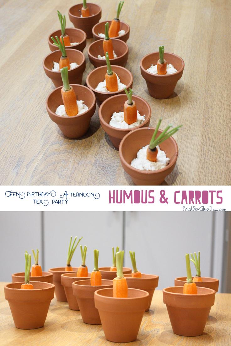 Humous and carrots in mini terracotta pots