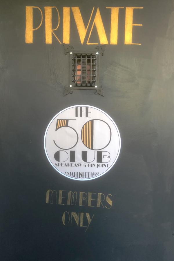 Closeup of speakeasy door peephole