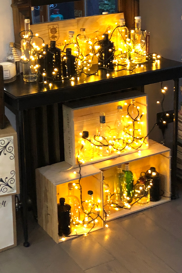 Gin Bottle decorations with lights at speakeasy party