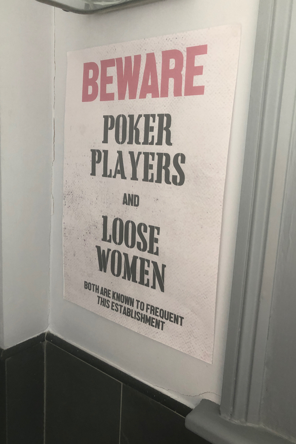 beware poker players and loose women poster at speakeasy party