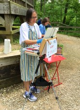 Working on a pastel along the trail overlooking Clifty canyon and next to a handy shelter in case of rain.