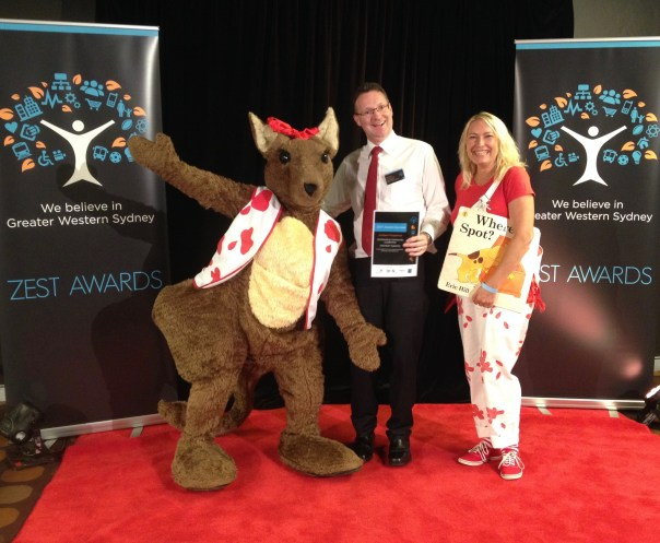 Paint Penrith REaD's Community Champion, Graham Fitzpatrick, flanked at the ZEST Awards by Julieanne Woods and Rooby Roo.