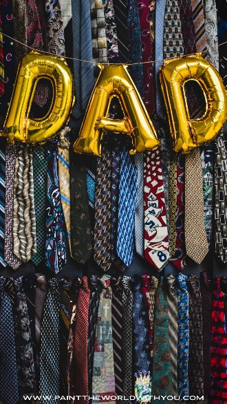 The word DAD with ties in the background