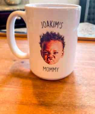 A cool white personalized mug with first born son pictured on front and back of cup.