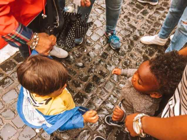 Toddlers in Rome interacting.