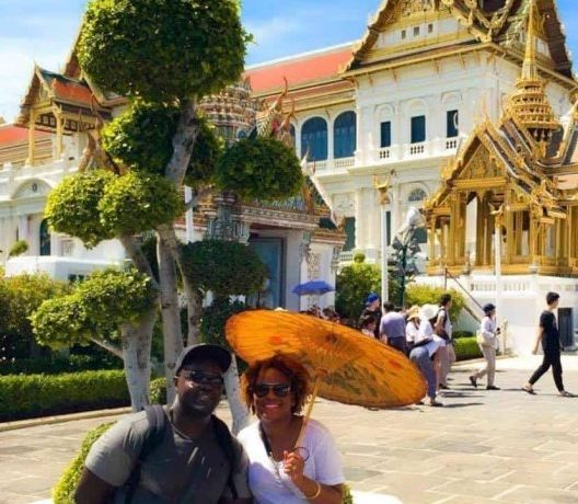 A couple taking a photo in Bangkok at The Grand Palace