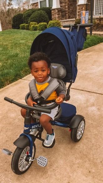 Toddler on his Bentley trike in blue.