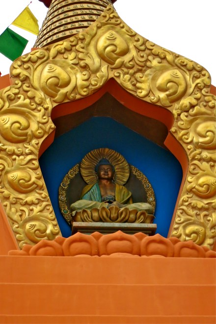 Image of Amitabha in faceplate