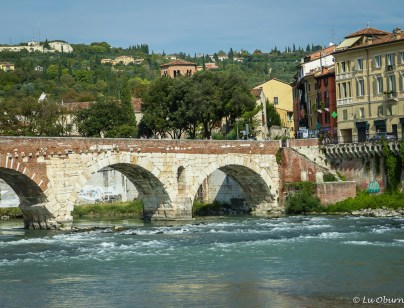 Ancient Roman wall spanning the Adige river