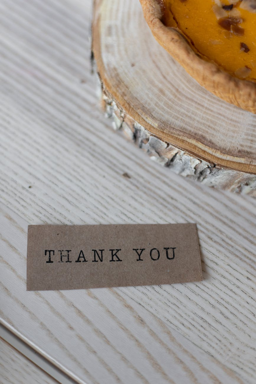 paper with thank you inscription on table