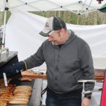 cooking sausage at the Bluffs Maple Syrup weekend