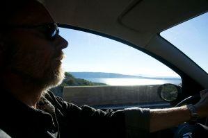 Per driving along the sea