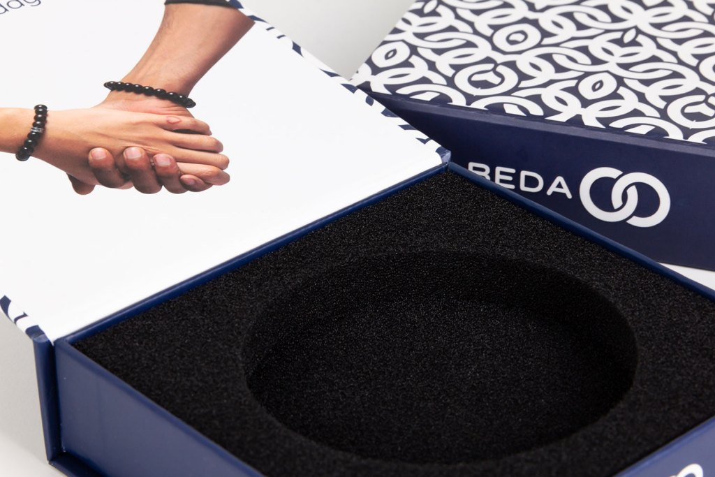 A view of the inserts for the custom packaging of Beda Beads.