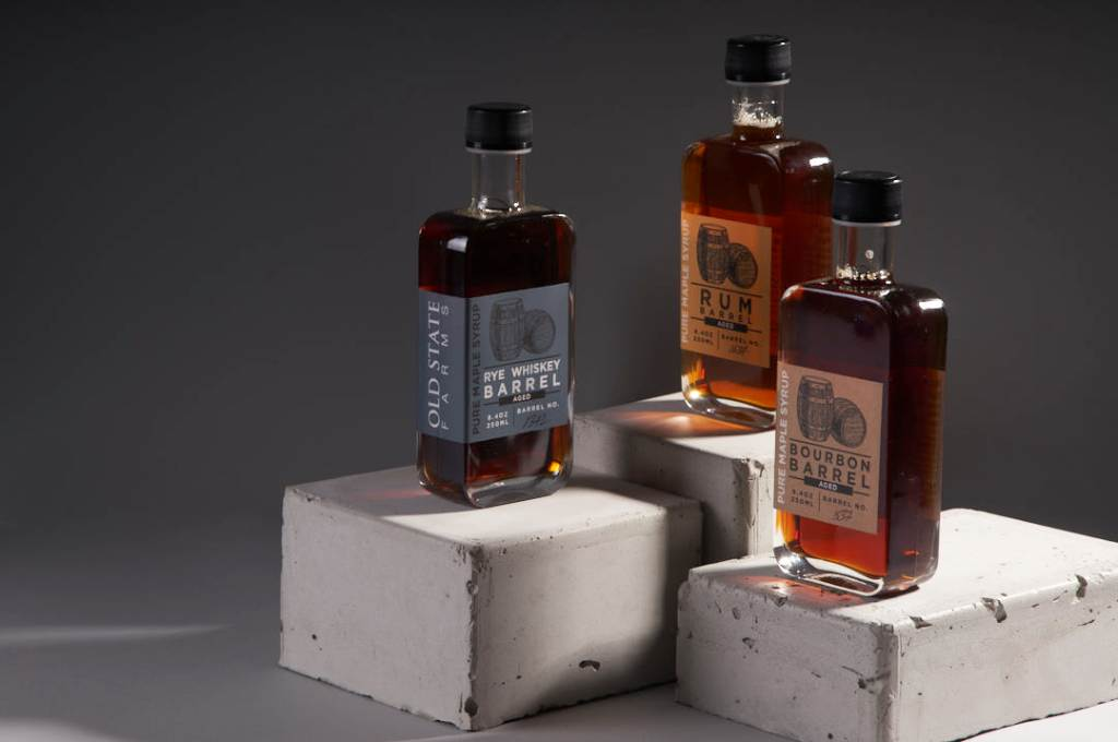 Images of three bottles of rye whiskey, rum, bourbon maple syrup