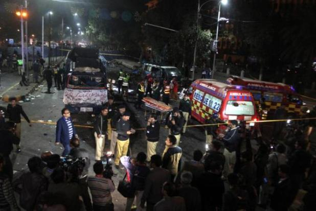 Police and rescue workers work at the scene of a blast in Lahore