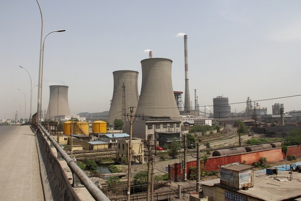 Over 70% of China's electricity is supplied by coal-fired power plants. One of the most noticeable features of these power plants is the cement cooling towers. (Photo by V. T. Polywoda, Creative Commons License)