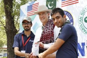 English Access Micro-scholarship Program Alumnus Kamran Javed and Benjamin Franklin Institute Alumnus Faran Ali with U.S Ambassador Richard Olson at the camp