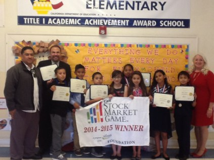 Mr. Ramos, Mr. Flores and Wendy Thompson on the right with Mr. Ramos' 5th grade class