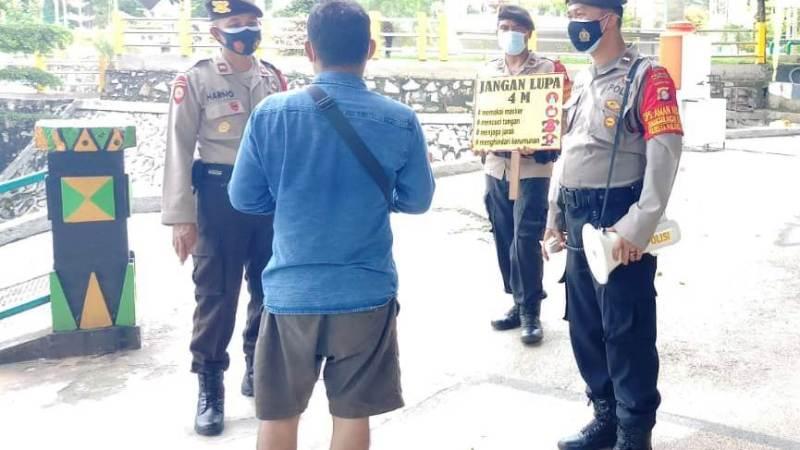 Satgas Aman Nusa II Polresta Palangka Raya Ajak Masyarakat Disiplin Patuhi Prokes Cegah Covid-19