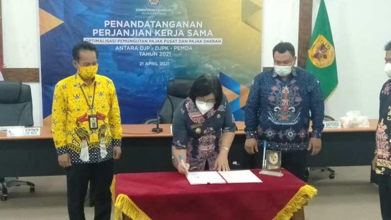 Penandatanganan PKS Antara Pemkab Gumas bersama DJP dan DJPK Pusat.