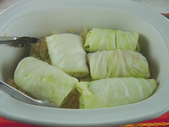Placing cabbage rolls in the crock pot